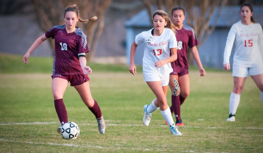 Ada junior Maryanne Criswell (19) pushes the ball up the field in action earlier this spring. The Lady Cougars defeated Bristow 4-1 Monday night and travel to Cleveland on Friday.