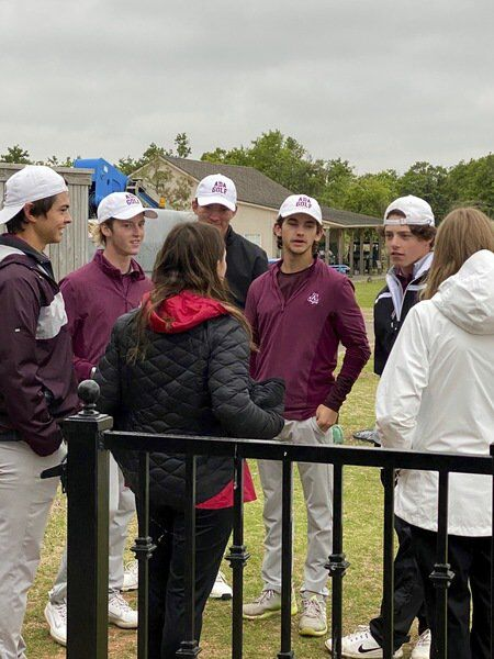 Ada High golfers Derek Layton, David Anderson, David Johnson, Michael Huff and Mack Weems are shown standing around during a weather delay that lasted well over two hours Tuesday at the Class 4A State Tournament hosted by the Winter Creek Golf and Country Club in Blanchard.