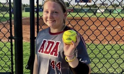 Ada freshman Bradi Odom shows off the ball after she cranked a two-run homer in the Lady Cougars' district matchup with Classen SAS Monday evening.