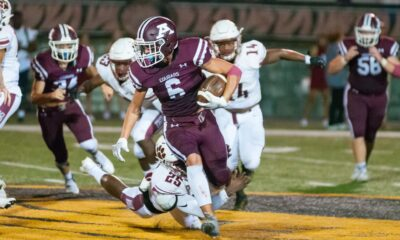 Richard R. Barron | The Ada News -- Ada running back Kaden Gallagher (6) finds some running room as Ardmore defender CJ Williams (25) dives at his feet during their Week 1 matchup Friday night at Norris Field. Gallagher finished with seven rusher for 19 yards in the contest.